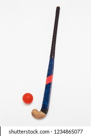 Hockey stick and ball on white background