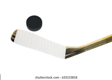Hockey stick and puck isolated on white background