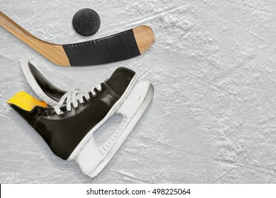 Hockey sticks, skate and puck on the ice. Texture, background