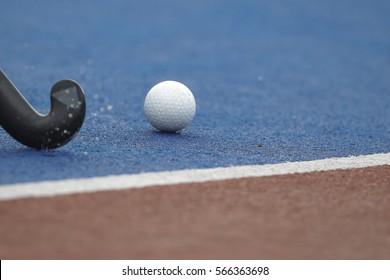 Hockeys stick and ball.