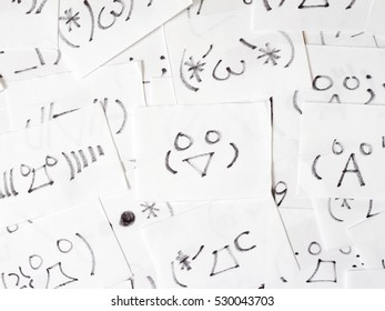 Hodgepodge of handwritten Japanese emoticon cards, high angle