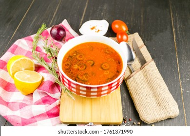 hodgepodge on a wooden background with a linen towel - Shutterstock ID 1761371990