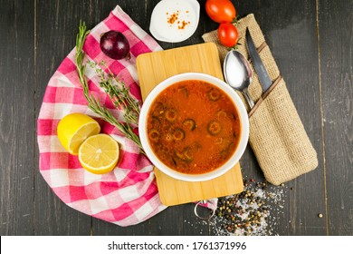hodgepodge on a wooden background with a linen towel - Shutterstock ID 1761371996