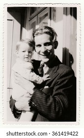 HODONIN, THE CZECHOSLOVAK REPUBLIC, CIRCA 1941: A small girl with her uncle, circa 1941