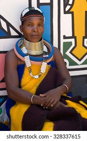 HOEDSPRUIT, SOUTH AFRICA - FEBRUARY 27: a ndebele woman while sitting in a typical dress of the village february 27, 2007 in Hoedspruit, South Africa