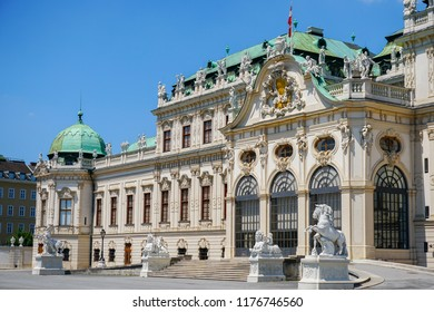 Hofburg imperial palace of Habsburg dynasty in Wien with lion statues, Austria. Concept of euopean landmarks and architecture in Vienna.