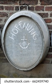 Hoffnung = hope, with cross and heart  - drawn with chalk