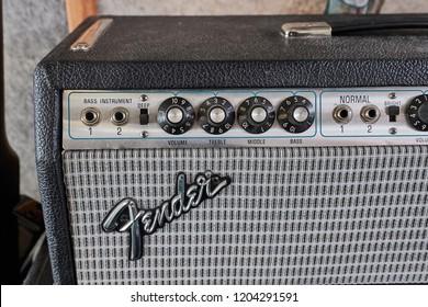 HOFN, ICELAND - MAY 4, 2018: Fender Bassman 135 vintage amplifier head on a big speaker cabinet