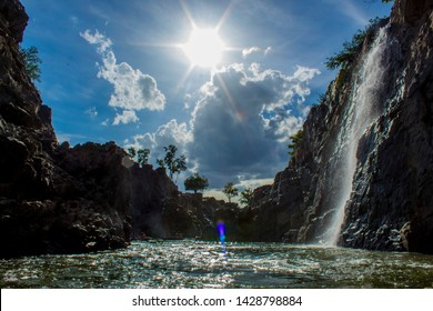 Hogenakkal is a waterfall in South India on the Kaveri river in the Dharmapuri district of the Indian state of Tamil Nadu. It is located 180 km from Bangalore and 46 km from Dharmapuri.