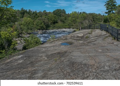 Hog's Back waterfalls located on the Rideau River in Hog's Back park in Ottawa, Ontario, Canada; here used to be bottom of a shallow sea 400 million years ago.