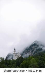 Hohenschwangau, Bavaria/Germany - August 8, 2017: Neuschwanstein castle on a foggy morning