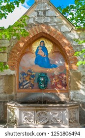 Hohenschwangau, Bavaria/Germany - MAY 2008: Full view of the famous Mary's Fountain at the courtyard of Hohenschwangau castle. Above a lion's head spout is a painting of Mary holding the baby Jesus.
