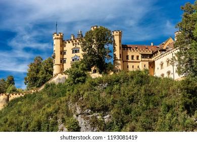 Hohenschwangau Castle (Schloss Hohenschwangau - Upper Swan County Palace 19th century), landmark in the Bavarian Alps, Germany.