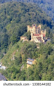 Hohenschwangau Castle  surrounded by forest in summer time. It is a 19th-century castle in southern Germany. It was the childhood residence of King Ludwig II.