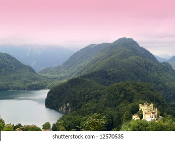 Hohenschwangau castle view from mountain with pink filtered sky