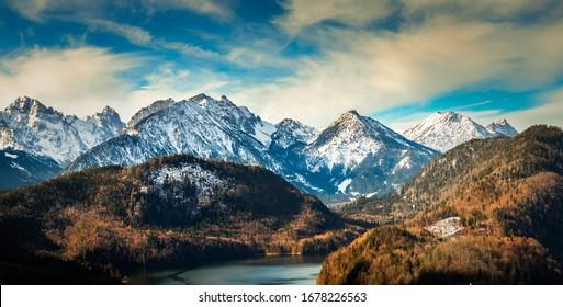 Hohenschwangau, Germany - february 15 2020: Alps mountains in germany near the Hohenschwangau lake, castle and town. View from Neuschwanstein castle balcony.
