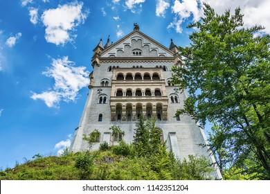 Hohenschwangau, Germany - June 10, 2018: The idyllic Neuschwanstein Castle positioned high up on a mountain in the Bavarian Alps. Commissioned by King Ludwig II of Bavaria.