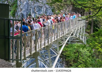 Hohenschwangau, Germany - June 10, 2018: Tourists pose for pictures on Marienbrücke (also known as Marie's Bridge or Pöllatbrücke), an ideal spot for photographing Neuschwanstein Castle.