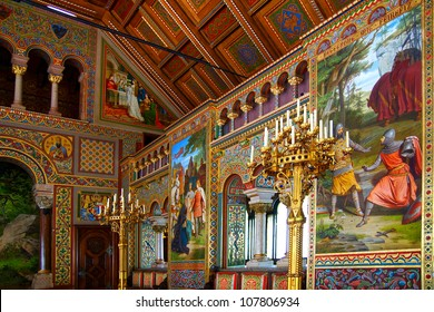 HOHENSCHWANGAU, GERMANY - JUNE 11: Interior of the Neuschwanstein Castle in Hohenschwangau. June 11, 2012 Near Fassen in Germany.  The luxurious Walls of the Castle are paintings by medieval legends.