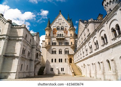Hohenschwangau, Germany - June 6, 2016: The magnificent New Swan Stone Castle - Schloss Neuschwanstein perched on a cliff surrounded in Schwangau, Bavaria, Germany