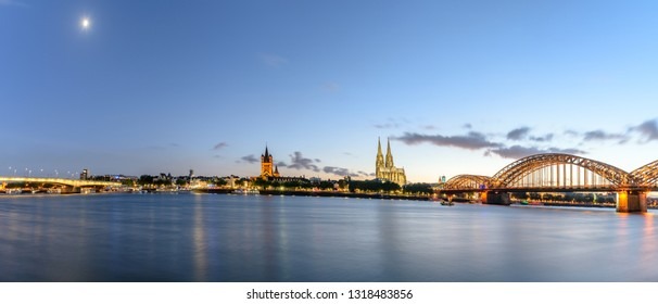 Hohenzollern bridge and Cologne's cathedral can be seen  along the riverside, and its twin towers protrude the cityscape