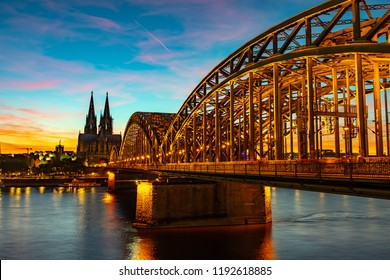 Hohenzollern Bridge and Cologne Cathedral in Koln, Germany.
