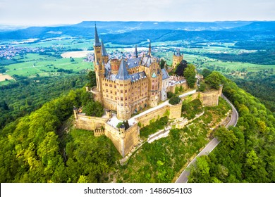 Hohenzollern Castle on mountain, Germany. This castle is a famous landmark in Stuttgart vicinity. Aerial panoramic view of Burg Hohenzollern in summer. Landscape of Swabian Alps with Gothic castle.