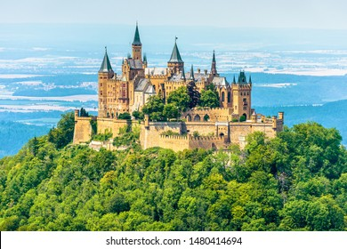 Hohenzollern Castle on mountain top, Germany. This castle is a famous landmark in vicinity of Stuttgart. Scenic view of Burg Hohenzollern in summer. Landscape of Swabian Alps with Gothic castle.