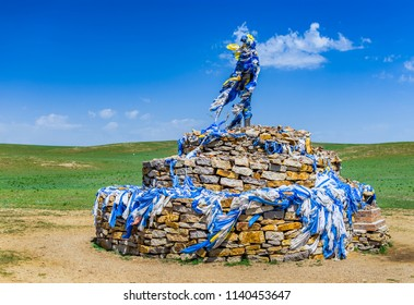 Hohhot, Inner Mongolia / China - July 30 2016: An ovoo, a traditional Mongolian monument worshiping the cult of mountains and sky, usually in the shape of a pile of stones, Inner Mongolia, China.