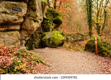 Hohllay, Berdorf, Luxembourg - November 9, 2017: The Mullerthal Trail passes the ancient millstone mine known as Hohllay