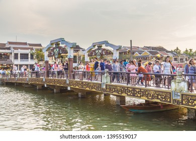 HOI AN - 24TH MARCH 2017: A bridge over the Thu Bon River connecting to the Ancient Town. Lots of people can be seen on the bridge