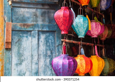Hoi An, central Vietnam. February 25, 2013 . The traditional Vietnamese silk lanterns on a background of the blue wall.