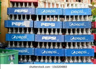 Hoi An, Quang Nam Province / Viet Nam - September 27 2019: Empty Pepsi bottles stacked for recycling
