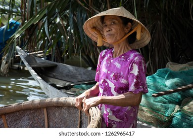 Hoi An, Quang Nam, Vietnam - 12/5/2018:  Mrs Phong, whose nickname was 'Sexy Lady'. She was a 66-year old who specialised in making basket boats.