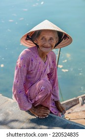 Hoi An, Vietnam - 14 August: Unidentified woman poses for the camera August 14, 2014 in Hoi An, Vietnam