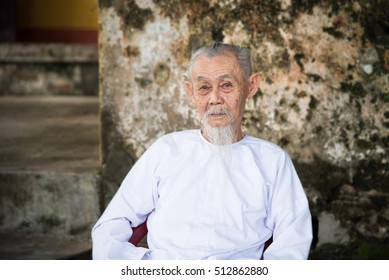 Hoi An, Vietnam - 18 October 2016: Vietnamese old man in white shirt. Hoi An old town.