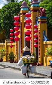 Hoi An, Vietnam, 22 October 2018: Red lanterns hanging on the facade of an old building