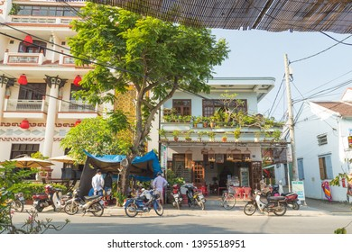 HOI AN, VIETNAM - 24TH MARCH 2017: Streets in Hoi An showing the outside of buildings and people.
