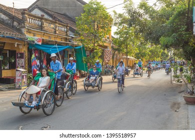 HOI AN, VIETNAM - 24TH MARCH 2017: Large amoutns of people on Cyclo tours along streets of Hoi An during the day