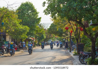 HOI AN, VIETNAM - 24TH MARCH 2017: Road and streets in Hoi An showing people and traffic.