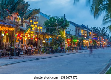 HOI AN, VIETNAM - 24TH MARCH 2017: A view of Nguyen Phuc Chu Dang street in Hoi An. Colourful lights, buildings and people can be seen.