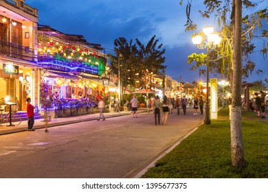 HOI AN, VIETNAM - 24TH MARCH 2017: Nguyen Phuc Chu Street in Hoi An at night showing the outside of restaurants, architecture and people.