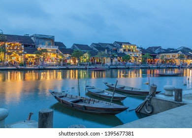 HOI AN, VIETNAM - 24TH MARCH 2017: A view over the  Thu Bon River towards Bach Dang street in Ancient Town. Colourful lights, buildings, reflections and people can be seen.