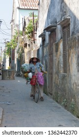 Hoi An, Vietnam - 26th February 2010: Vietnamese woman on bicycle. This mode of transpor
