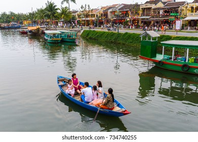 HOI AN, VIETNAM - 4/19/2016: A family of tourists take a boat ride in Hoi An, Vietnam.