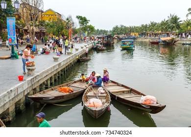 HOI AN, VIETNAM - 4/19/2016: Riverside tour boats docked along the waterfront in Hoi An, Vietnam.