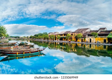 Hoi An, Vietnam - august 11th 2018: View of busy river in Hoi An, Vietnam. Hoi An is the World's Cultural heritage site, famous for mixed cultures and architecture.
