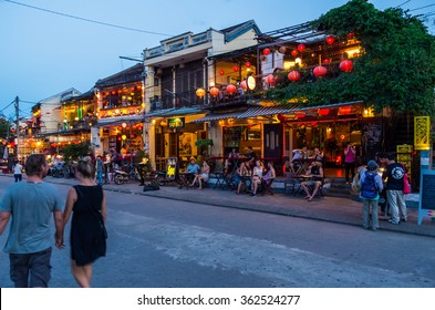 Hoi An, Vietnam - August 14, 2015: colourfully lit restaurants along the Thu Bon River front across the river from Hoi An Ancient City UNESCO World Heritage Site.