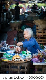 Hoi An, Vietnam - Dec 1, 2015. An old woman at local market in Hoi An Ancient Town, Vietnam. Hoi An is Vietnam most atmospheric and delightful town.
