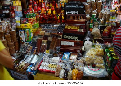 HOI AN, VIETNAM - FEB 3, 2015 - Stall selling incense, calligraphy supplies and other items in the central market of  Hoi An, Vietnam